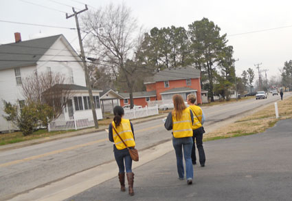 Students left in groups to conduct health assessments in Tyrrell County neighborhoods.