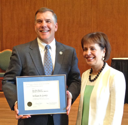 Bill Gentry (left) accepts the Brooks Award from Chancellor Carol Folt.