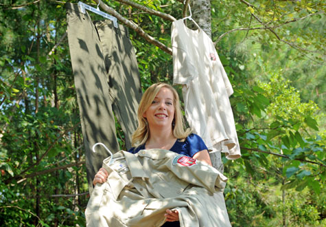 Dr. Meagan Vaughn displays forestry workers' uniforms that have been treated with the tick repellent permethrin.