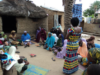A credit officer presents breastfeeding information during a monthly microcredit meeting in Bauchi State, Nigeria.