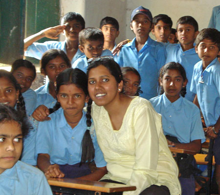 Gopalakrishnan recently completed her master's thesis project on menstrual hygiene practices in India. Prior to coming to UNC, she has worked on several social sector projects. Here, she is pictured with children in a classroom in Gulbarga (Karnataka), where she was collecting data for a school meal program in India.