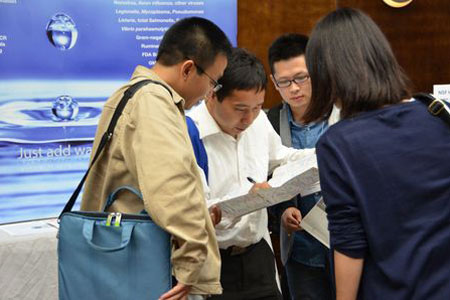 Attendees at the inaugural Water and Microbiology conference review program materials.