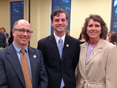 Jerry Salak (left) and Lori Evarts (right) attended The Order of the Old Well induction ceremony to celebrate the induction of PHLP student Spencer Lindgren (center).