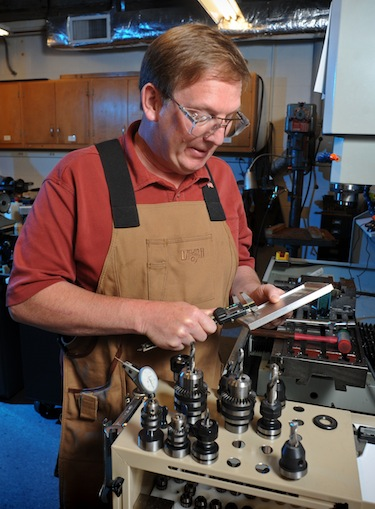 Dr. Glenn Walters works in his shop in Rosenau Hall.