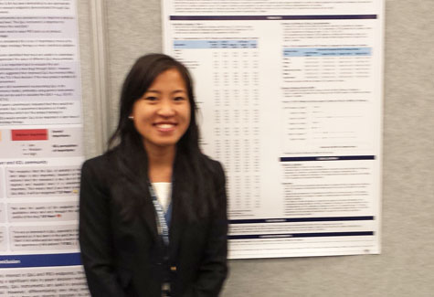 Caroleen Quach stands in front of her winning research poster.
