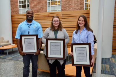Left to right are Melvin Powell, Cortney Pylant and Stephanie Forman, the recipients of 2019 Staff Excellence Awards.