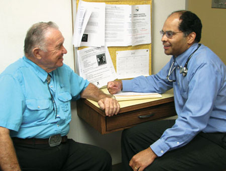 Dr. D.J. McFadden chats with a client. Photo courtesy of The Mennonite magazine.