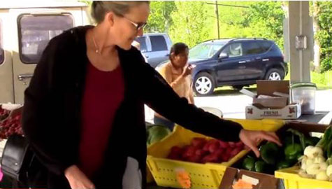 Dr. Alice Ammerman selects peppers at the Kinston, N.C., Farmers Market. Ammerman won a prize for heart-healthy hushpuppies at the Kinston barbeque festival this year. Photo still courtesy of HPDP video.
