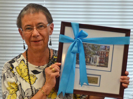Priscilla Guild, ougoing alumni association president, was honored at her final meeting in June.