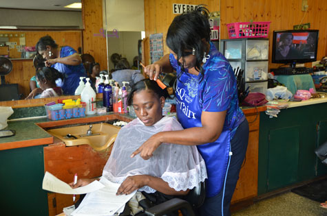 Much of Linnan's own research involves dissemination of health information through salons and barber shops. Here, Donna Hooker, proprietor of Donna's Hair Salon, in Sanford, N.C., talks with a customer about how to prevent falls. Linnan and colleagues have worked closely with Ms. Hooker and other barber shop and salon owners to share health information with people who otherwise might not have access to it.