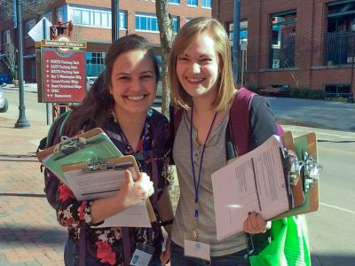 Photo: Christina Villella and Alex Coombs (both MPH, 2016) conduct a community survey about Durham's no-smoking policy as part of their Capstone project.