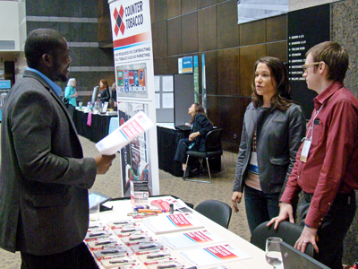 Dr. Allison Myers (center) hosts a Counter Tobacco booth at the Minority Health Conference.