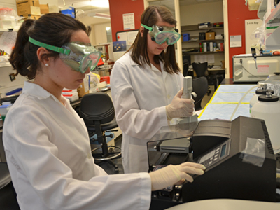 Two students run a test in one of the metabolic nutrition labs.
