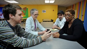 David Cavallo,left and Alice Ammerman, second from left meet with officials at Chapel Hill High School.
