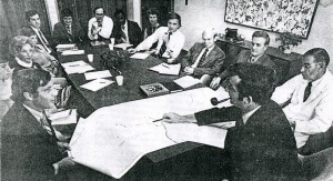 Glenn Wilson (foreground) talks with UNC medical school staff (circa 1972) about a project proposal that led to an $8.5 million contract to establish N.C. AHECs