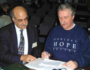 Dr.William Zelman (left) works with a Project Hope participant in Poland in the 1980s