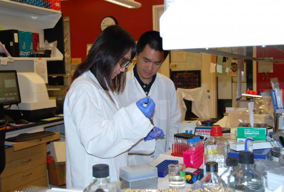 Two student researchers work in the Baric lab.