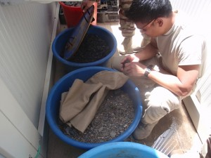 Major Jay Reyes with sand filter