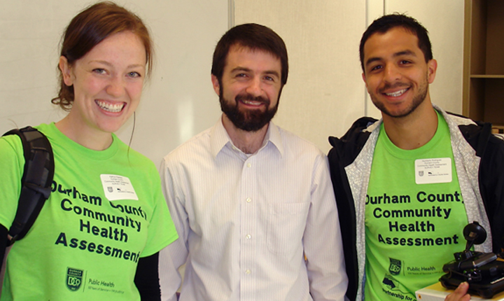 NCIPH staff Matt Simon (center) provides assistance to the Durham County Department of Public Health for health opinion surveys with volunteers Kathryn Peebles (left) and Humberto Rodriguez (right).