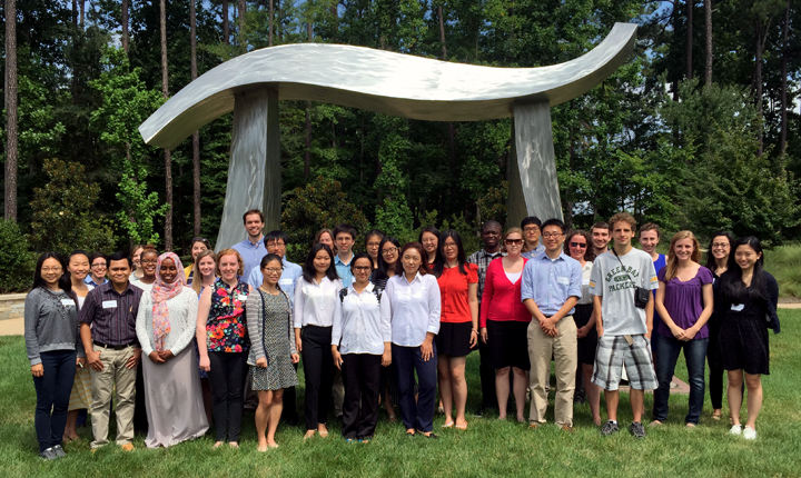 Students pose in front of the pi sculpture at the SAS campus in Cary, NC.