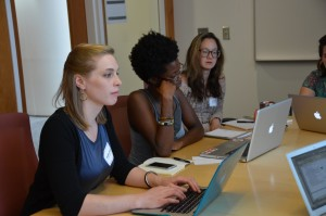Caitlyn Snider, Adébukola Oni and Hyun Namkoong meet with potential capstone community partners.