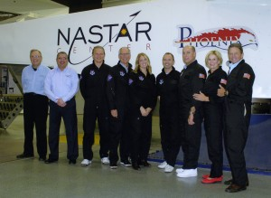Holzworth, fourth from left, poses with his partners-in-training at the National Aerospace Training and Research (NASTAR) Center. (Photo courtesy of Virgin Galactic)