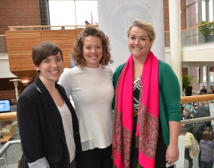 Meg Landfried (left) poses with capstone teaching assistants Melissa Cox (center) and Christine Agnew-Brune during a final presentation of team projects.