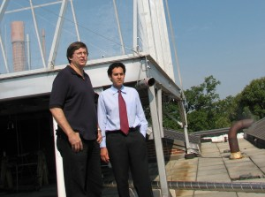 Dr. Ken Sexton (left) and Dr. Will Vizuete describe the operation of the smog chamber on top of McGavran-Greenberg Hall. (Photo by Linda Kastleman)