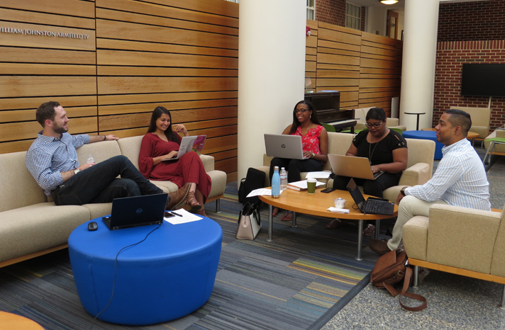 HPM students chatting in Hooker Atrium