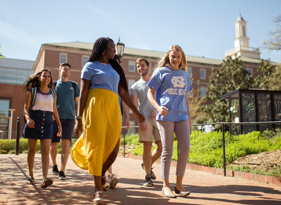 Students walk in front of Rosenau Hall.