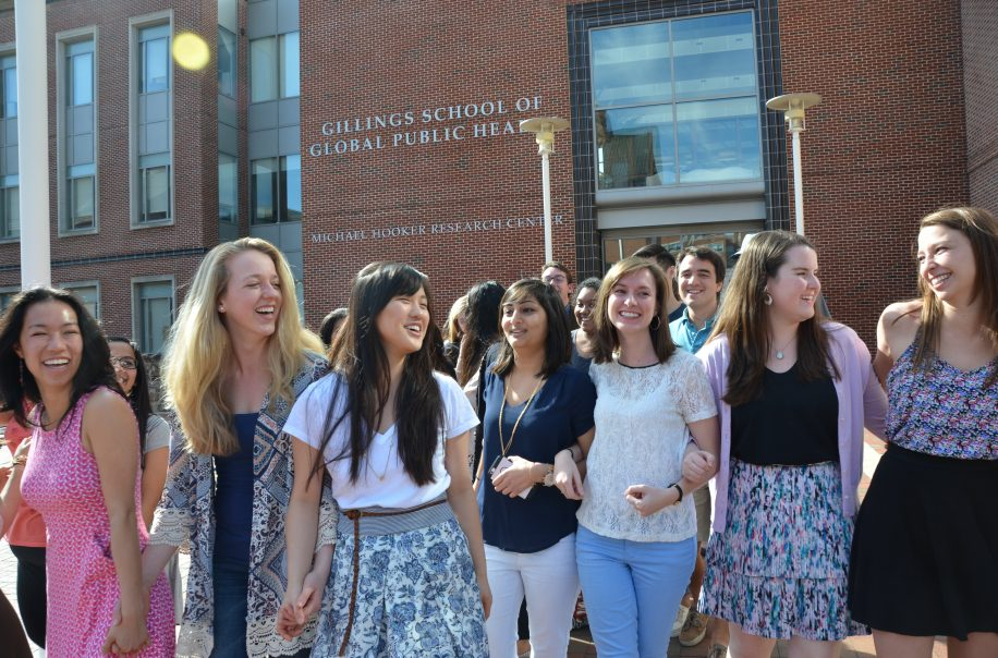 Students smile as they walk out of the Atrium.