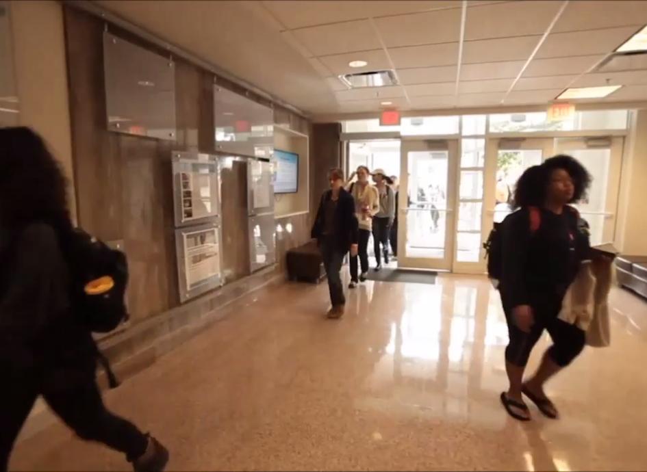 Students stream into the Rosenau Hall lobby before class.
