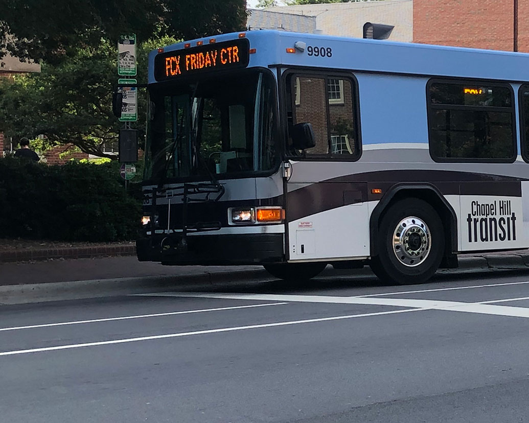 A bus makes a stop on the UNC campus.