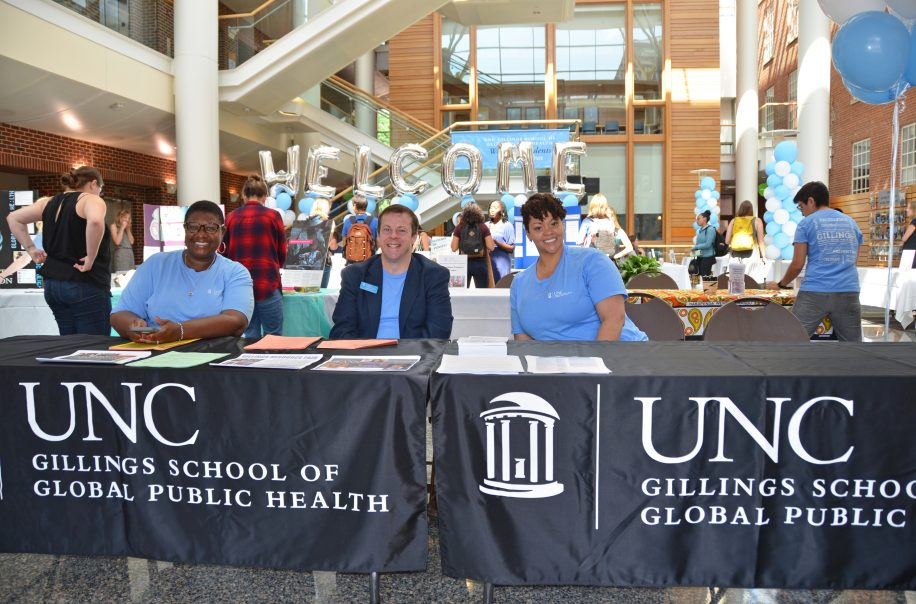 Members of the Office of Student Affairs welcome students.
