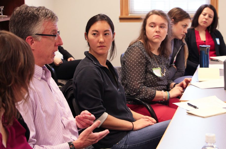 Students listen to a professor's lecture.