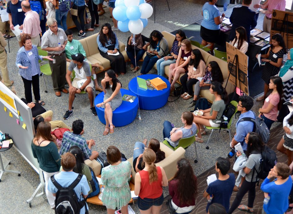 Students attend an open house in the Gillings Atrium.