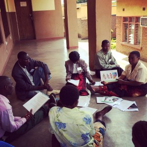 Volunteers break into small groups to practice using breastfeeding counseling cards at the Nathenje training. Photo by Hillary Murphy