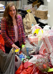 Zoey Frolking sorts through one of the many overflowing bags of Angel Tree gifts.
