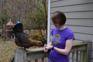 Susie Smith offers a treat to her favorite chicken, Lolo. (Contributed photo)