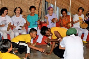Dr. Courtney Woods (center, right, in yellow shirt) participates in a capoeira angola circle. Photo courtesy of Rita Barreto.