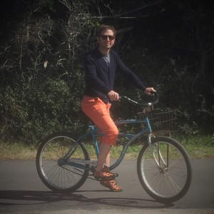 Bryan Andregg bikes in some of his signature colorful clothes. (Contributed photo)