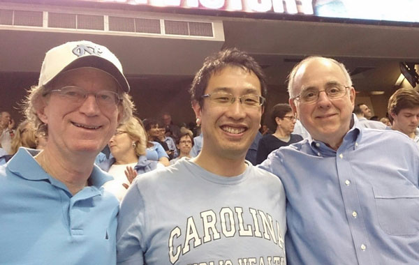 At UNC basketball game in Dean E. Smith Center with David Steffen and Bill Sollecito, PHLP.