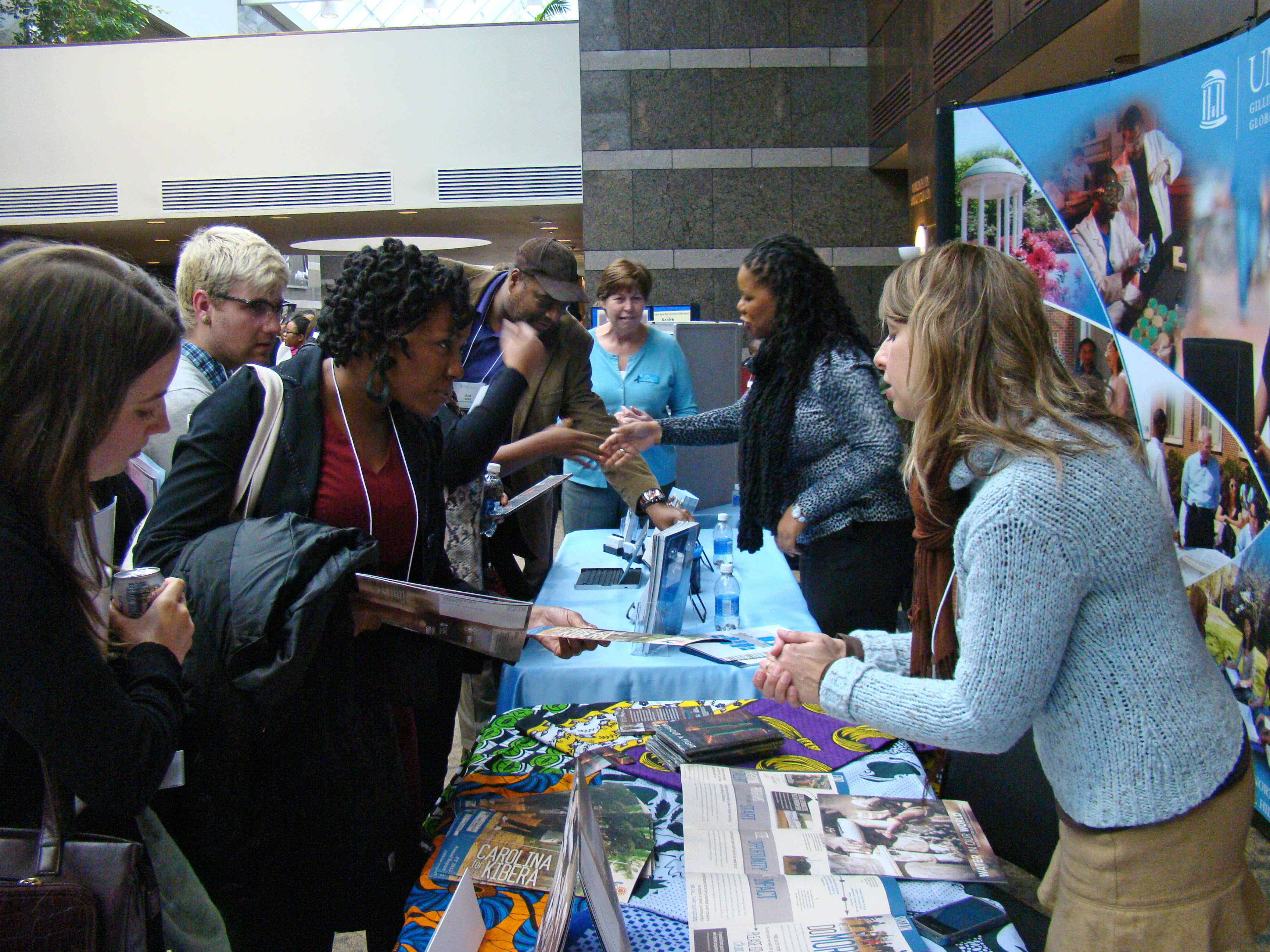 Participants at the 2016 Minority Health Conference examine materials from related organizations at UNC.