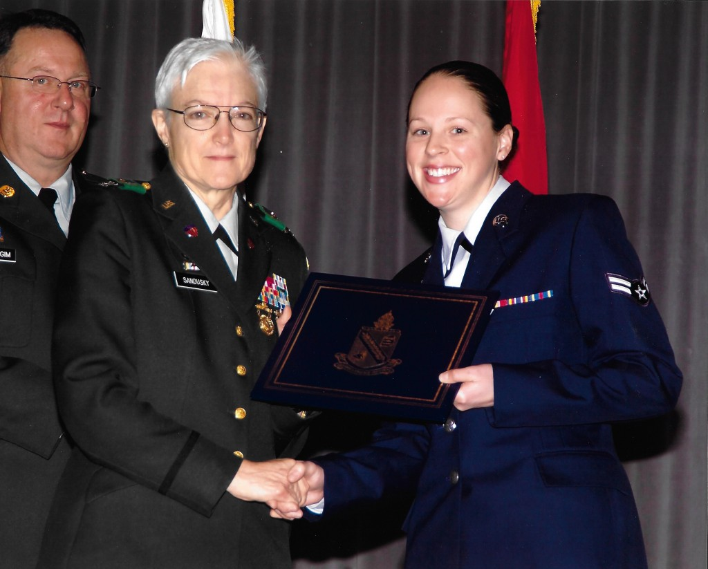 Marie Callahan (right) accepts a diploma at her Defense Language Institute graduation. (Contributed photo)