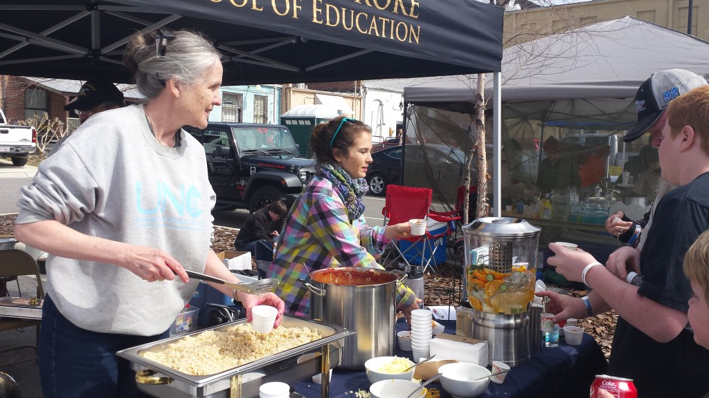 Dr. Ammerman (left) serves her Sweet Beat Rumba Chili at a chili cook-off in Robeson County in March 2016. (Photo by Catherine Rohweder)
