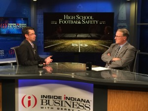 Dr. Zachary Kerr (left) discusses football injuries with host Bill Benner on Inside INdiana Business Televison. (Contributed photo)