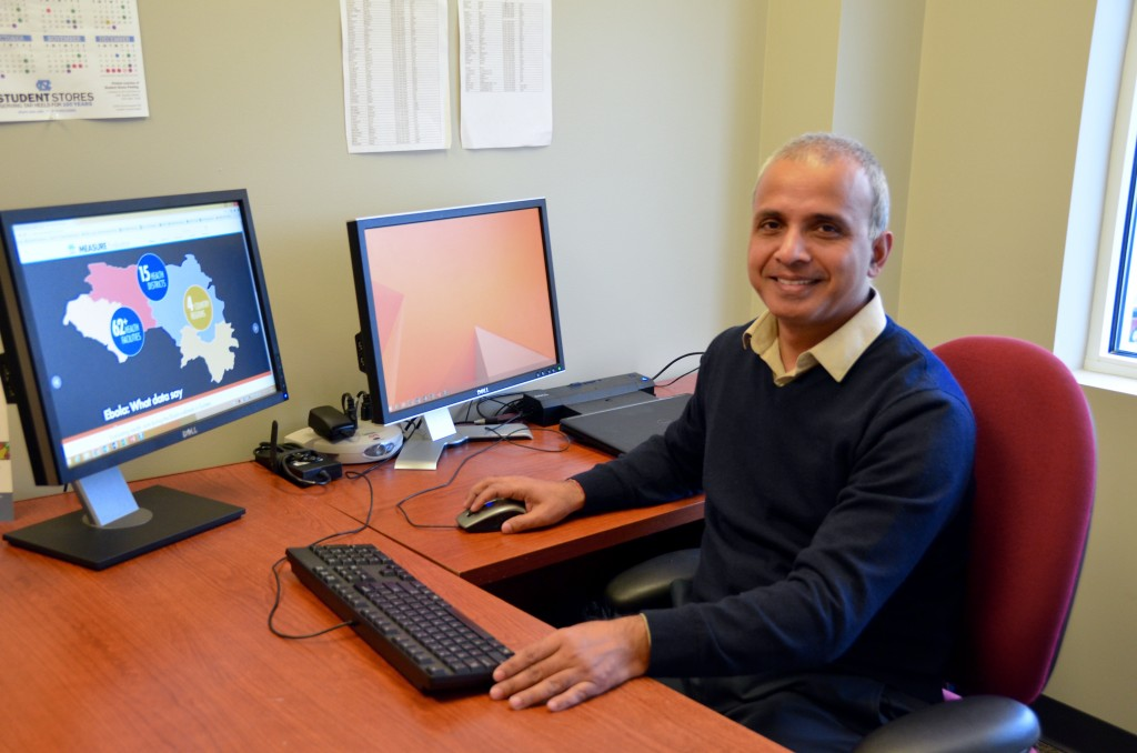 Manish Kumar works in his MEASURE Evaluation office in Chapel Hill, N.C. (Photo by Jennie Saia)