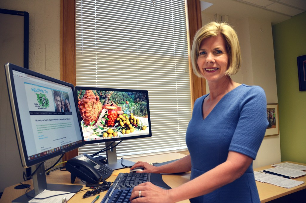 Dr. Beth Mayer-Davis, at her standing desk, reviews the website for her Flexible Lifestyle Empowering Change (FL3X) project. (Photo by Linda Kastleman)