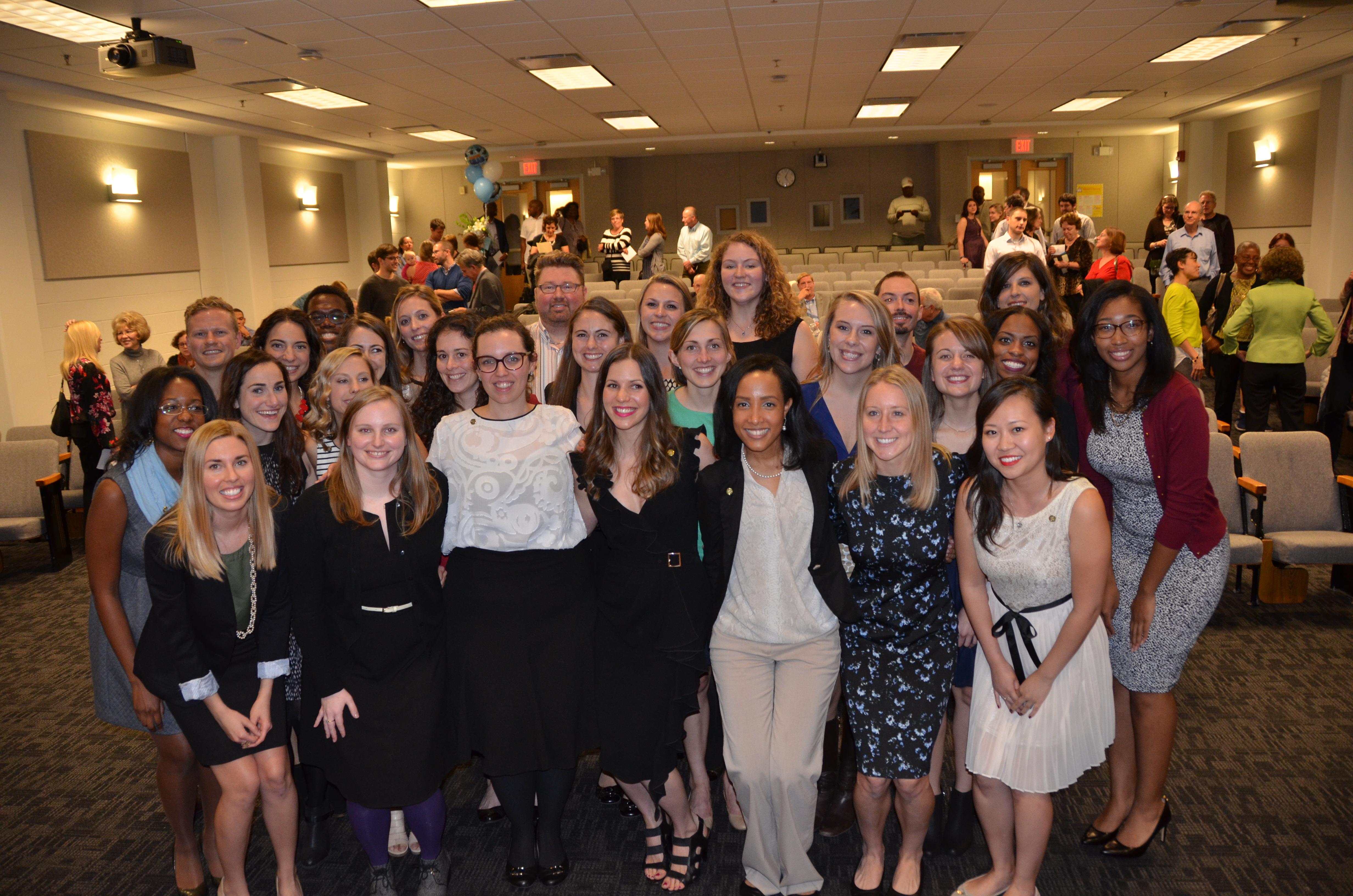 Graduates from the Department of Nutrition celebrate in Rosenau Auditorium.