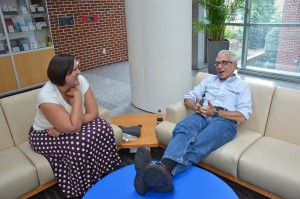 Dr. Morris Weinberger and Melanie Studer chat in Armfield Atrium.